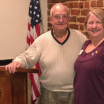 Bob Doberstein of Buddy Backpacks of Harnett County with Club President Karen Kratz